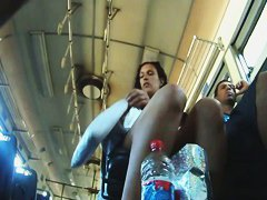 Up-skirt video shows a randy bus voyeur filming a beautiful girl with...