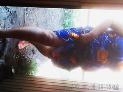 Amateur mature in flowered dress has uncovered her old pussy outdoor. It...
