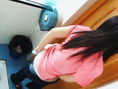 Beautiful Asian babe takes her pants off to urinate in a school toilet.
