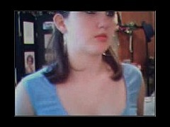 Young teenage cutie posing on her webcam