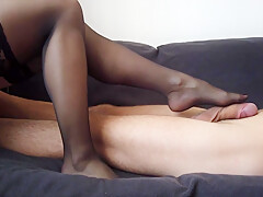 A sensual footjob by sexy feet in black stockings