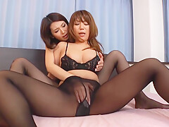 Two Asian mature lesbians in nylon stockings having some naughty fun in bed